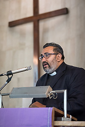 8 December 2019, Madrid, Spain: Bringing word from churches in the Pacific region, Rev. James Bhagwan, general secretary of the Pacific Conference of Churches speaks as Christians from around the globe gather with local congregants in the Iglesia de Jesús in central Madrid, to celebrate an ecumenical prayer service during COP25.
