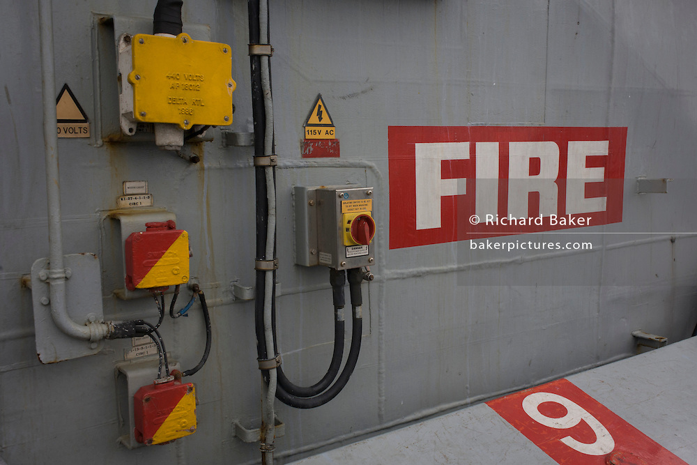"""Emergency fire muster station point on-board the Royal Navy's aircraft carrier HMS Illustrious. Illustrious is the second of three Invincible-class light aircraft carriers built for the Royal Navy in the late 1970s and early 1980s. She is the fifth warship and second aircraft carrier to bear the name Illustrious, and is affectionately known to her crew as """"Lusty"""". She is the oldest ship in the Royal Navy's active fleet , expected  to be  withdrawn from service in 2014 (after 32 years' service)."""