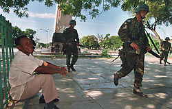US and UN troops arrive in Haiti as the first election since the coup and embargo that displaced Jean Bertrand Aristide takes place and Rene Preval is elected president. Port au Prince, Haiti, 1996.