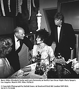 Barry Diller, Elizabeth Taylor and Larry Fortensky at Swifty's last Oscar Night  Party. Spago's. Los Angeles. March 1993. Film. 93256/21<br />