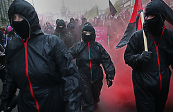 © Licensed to London News Pictures. 04/11/2015. London, UK. People dressed in black participate in a student demonstration in central London over tuition fees and cuts. Photo credit: Peter Macdiarmid/LNP