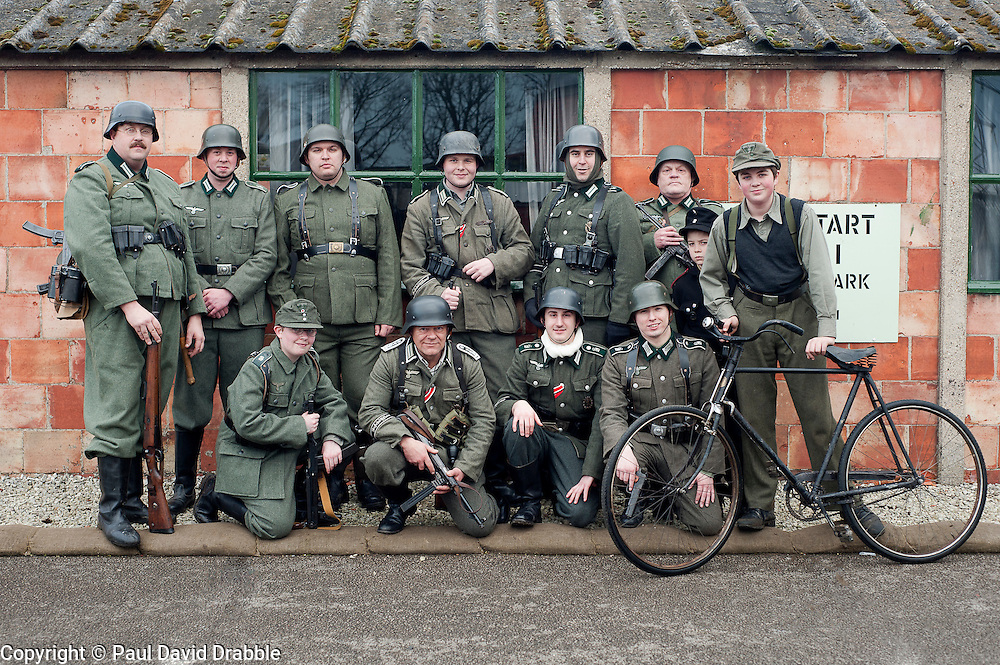 Reenactors portraying German panzer Grenadiers pose for a group photograph at Eden Camp Malton Nr Pickering<br /> Eden Camp 2012 NWW2A Membership Weekend<br /> http://www.pauldaviddrabble.co.uk<br /> 3 March 2012<br /> Image © Paul David Drabble