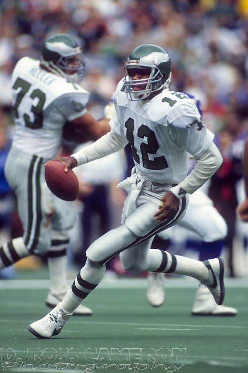 Philadelphia Eagles quarterback Randall Cunningham (12) breaks from the pocket on a keeper against the New York Giants during an NFL football game, Sunday, Oct. 8, 1989 at Veterans Stadium in Philadelphia, Pa. The Eagles won, 21-19. (Photo by D. Ross Cameron)