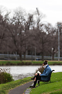 A woman wearing a scarf covering her face reads a book by the Yarra River during COVID-19 in Melbourne, Australia. Hotel quarantine linked to 99% of Victoria's COVID-19 cases, inquiry told. This comes amid a further 222 new cases being discovered along with 17 deaths. Melbourne continues to reel under Stage 4 restrictions with speculation that it will be extended. (Photo by Dave Hewison/Speed Media)