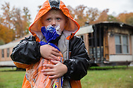 4 year old Marshall clutches a bag of carrots from a food distribution in his rural trailer community. Marshall and his grandmother were able to bring home bread, juice, potatoes and many other groceries. Eastern Tennessee: Food is delivered to a remote trailer community where unemployment leaves most residents with food insecurity. Families are often forced to choose between heating their mountain homes or purchasing food.