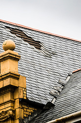 © London News Pictures. 02/03/2016. Aberystwyth, UK. <br /> Damage to the roof of the Ceredigion Museum in Aberystwyth as Storm Jake hits the Welsh coastline. <br /> 70mph gusts of wind have torn roof-slates off several of the older properties on seafront and brought down trees in the town centre. Photo credit: Keith Morris/LNP