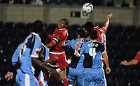 Photo: Richard Lane.<br />Wycombe Wanderers v Swindon Town. Johnstone's Paint Trophy. 17/10/2006. <br />Swindon's Jerel Ifil gets up to head the ball at goal.