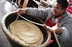 Jan. 30, 2018 - Sanmenxia, China - ZHAO ZENGTANG, a villager makes dried noodles in Beiwan village, Caiyuan township, Sanmenxia city of central China's Henan Province. Around 70 households in the village benefited from their handmade traditional dried noodles.   (Credit Image: © Zhu Xiang/Xinhua via ZUMA Wire)