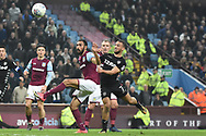 Leeds United midfielder Kemar Roofe (7) heads at goal during the EFL Sky Bet Championship match between Aston Villa and Leeds United at Villa Park, Birmingham, England on 13 April 2018. Picture by Alan Franklin.