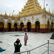 May 14, 2013 - Mandalay, Myanmar: Visitors at Mahamuni Buddha Temple in Mandalay. The city, famous for its pagodas, is a popular tourist destination for buddhist devotees from all over Southeast Asia. CREDIT: Paulo Nunes dos Santos