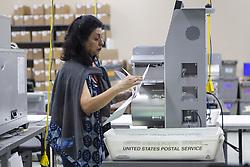 November 10, 2018 - Lauderhill, FL, USA - A worker reviews a ballot at the Broward County Supervisor of Elections office in Lauderhill, Fla., on Saturday, Nov. 10, 2018. (Credit Image: © Matias J. Ocner/Miami Herald/TNS via ZUMA Wire)