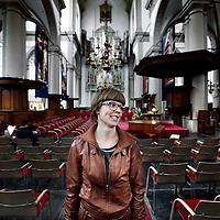 Nederland, Amsterdam , 2 juni 2014.<br /> Narda Beunders op de foto in de Westerkerk, architectuurstudente die een nieuw religieus gebouw ontwerpt. Vanuit de gedachte dat gebouwen iets met je doen.<br /> Foto:Jean-Pierre Jans