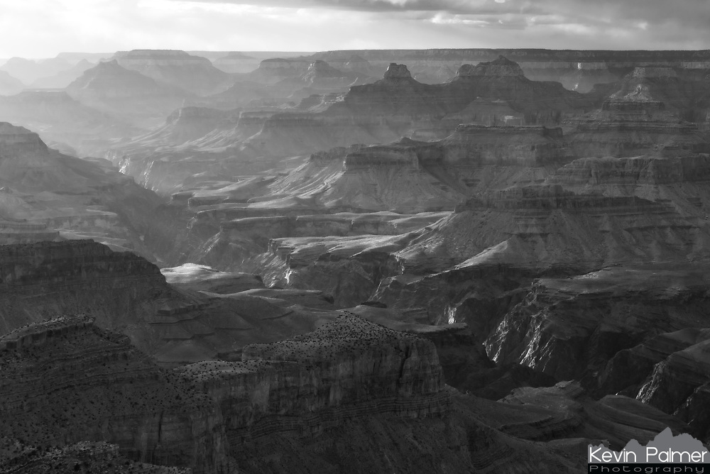 Sunlight illuminates the distant canyon as seen from Moran Point.