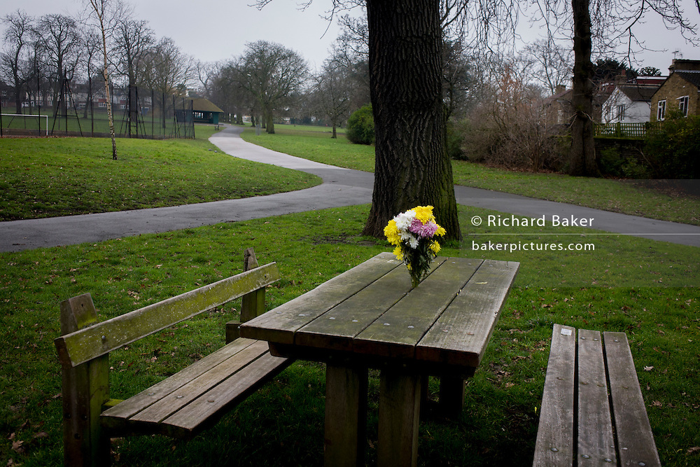 A bunch of fresh flowers left on a public park bench in Ruskin Park, south London borough of Lambeth.