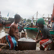 Joseph and Rene brings the catch onto land. Joseph is 17 and works like his father did on the sea as a fisherman. The catch of the day is hauled in by the entire crew to be sorted out on deck and taken straight to the market in Hinigaran. The catch that day made the crew $12.00 each( Captain Joan $24.00) One day a week Joseph goes to Alternative Learning schooling provided by Quidan-Kaisahan.  Quidan-Kaisahan is a charity working in Negros Occidental in the Philippines. Their aim is to keep children out of work to secure them education.
