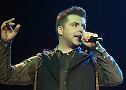 """Westlife Greatest Hits / Farewell Tour 2012 at the Metro Radio Arena Newcastle..15-06-12... ..Mark Feehily of  Irish Super Group Westlife perform during their sell out show at the Metro Radio Arena, in the English Leg of their Greatest Hits / Farewell World Tour. ..Westlife are an Irish boy band formed in 1998. They are to disband in 2012 after their farewell tour. The group's line-up was Shane Filan, Mark Feehily, Kian Egan, and Nicky Byrne. Brian McFadden was part of the group until 2004. Westlife have sold over 45 million records worldwide which includes studio albums, singles, video release, and compilation albums.. Despite the group's worldwide success, they only have one hit single in the United States, """"Swear It Again"""", which peaked in 2000 on the Billboard Hot 100 at number 20. The band were originally signed by Simon Cowell and are managed by Louis Walsh. The group have accumulated 14 number-one singles in the United Kingdom, the third-highest in UK history, tying with Cliff Richard..The group had also broken a few records, including """"Music artist with most consecutive number 1's in the UK"""", which consists of their first seven singles and only behind The Beatles and Elvis Presley..The band have 14 UK number ones and 25 top ten singles, consisting of 20.2 million records and videos in the UK across their 14-year career - 6.8 million singles, 11.9 million albums and 1.5 million videos. The Band are best known for amazing songs such as Flying Without Wings and Safe......At The Metro Radio Arena, Newcastle. England..Picture  Mark Davison/ ProLens PhotoAgency/ PLPA..Friday 15th June 2012."""