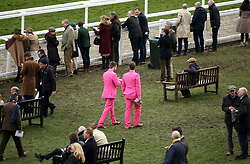 Racegoers in matching suits during Ladies Day of the 2018 Cheltenham Festival at Cheltenham Racecourse.