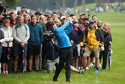 Northern Ireland's Rory McIlroy plays off the rough on the third fairway during day one of the 2018 BMW PGA Championship at Wentworth Golf Club, Surrey.