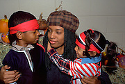Mom holding kids at Youth Express Halloween party age 25 4 and 2.  St Paul  Minnesota USA