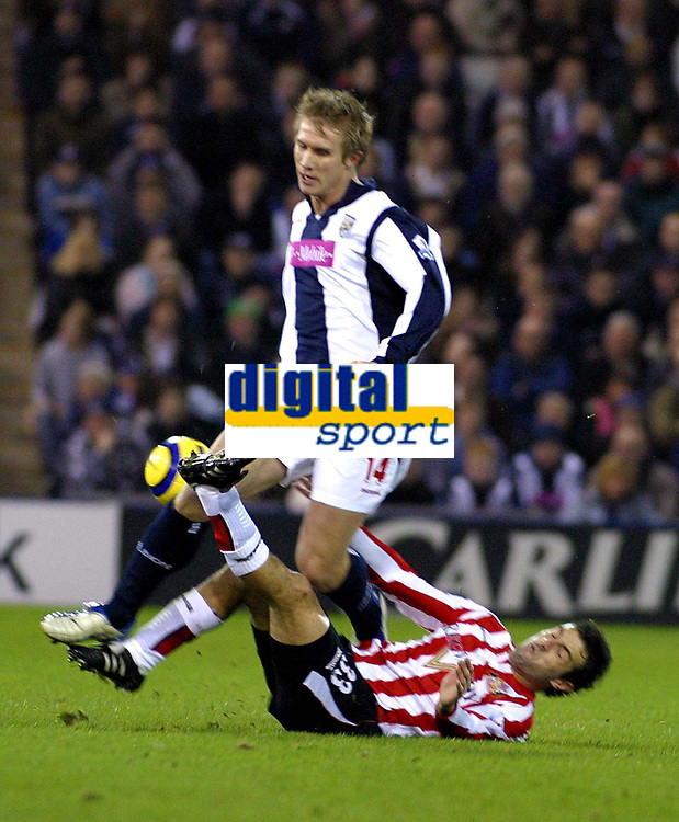 Photo: Dave Linney.<br />West Bromwich Albion v Sunderland. The Barclays Premiership. 21/01/2006.West Broms Martin Albrechtsen (L) tangles with   Julio Arca