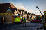 Kent Fire Services tackle a major fire at Morrisons supermarket in Folkestone, Kent. 8th November 2018. The fire started in the cafe chip fryer and spread rapidly through the store. 12 fire engines and two height vehicles attended the fire, it took over 8 hours to bring it under control. <br /> (photo by Andrew Aitchison / In pictures via Getty Images)