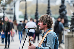 A busker performing on the South Bank in London.