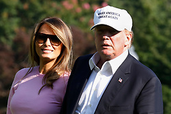 U.S. President Donald Trump walks with First Lady Melania Trump on the South Lawn of the White House upon their return to Washington on July 1, 2018 from Bedminster, NJ. Photo by Yuri Gripas/UPI