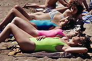 Sunbathing, Barceloneta beach, Barcelona, Spain.