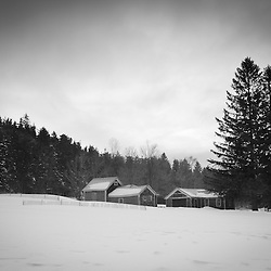 Old farm buildings at Notchview Reservation in Windsor, Massachusetts. Winter. The Trustees of Reservations.