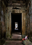 Hidden deep in the jungles of Cambodia's Angkor Archaeological Park, Preah Khan is a vast temple complex sprawling across nearly 140 acres. Built by the Khmer king Jayavarman the seventh in the late twelfth century as a monastery and center for learning, it was once the heart of a city of nearly 100,000.<br /> The temple is still largely unrestored: the initial clearing was from 1927 to 1932, and partial anastylosis was carried out in 1939. Since then free-standing statues have been removed for safe-keeping, and there has been further consolidation and restoration work. Throughout, the conservators have attempted to balance restoration and maintenance of the wild condition in which the temple was discovered