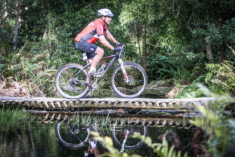 A rider crossing one of the many streams in the Tsitsikamma forest during day one of the Glacier Storms River Traverse mountain bike stage race held at the The Tsitsikamma Village Inn situated in Storms River Village on the Garden route, South Africa on the 6th August 2016<br /> <br /> Photo by: Oakpics.com / Dryland Event Management / SPORTZPICS<br /> <br /> <br /> {dem16gst}