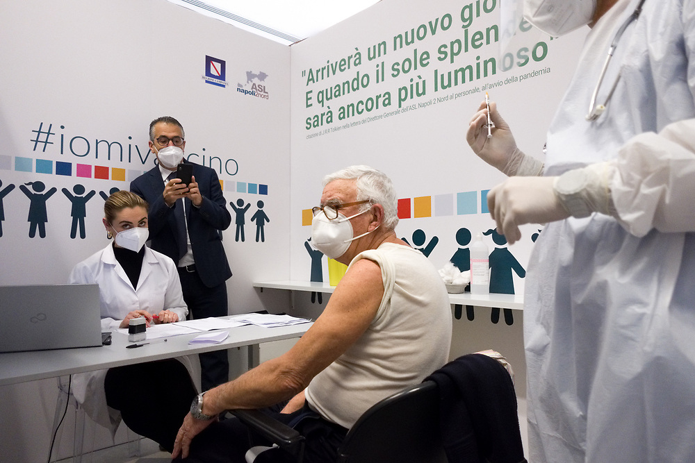 An elderly man is getting ready to receive a dose of the Pfizer-BioNTech COVID-19 vaccine on February 10, 2021 at the Covid Vaccine Center in Bacoli, southern Italy, as part of vaccinations for people over 80.