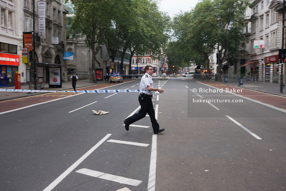 Suspect packages found outside premises in Central London force the closure of Holborn streets and evacuation of commuters.