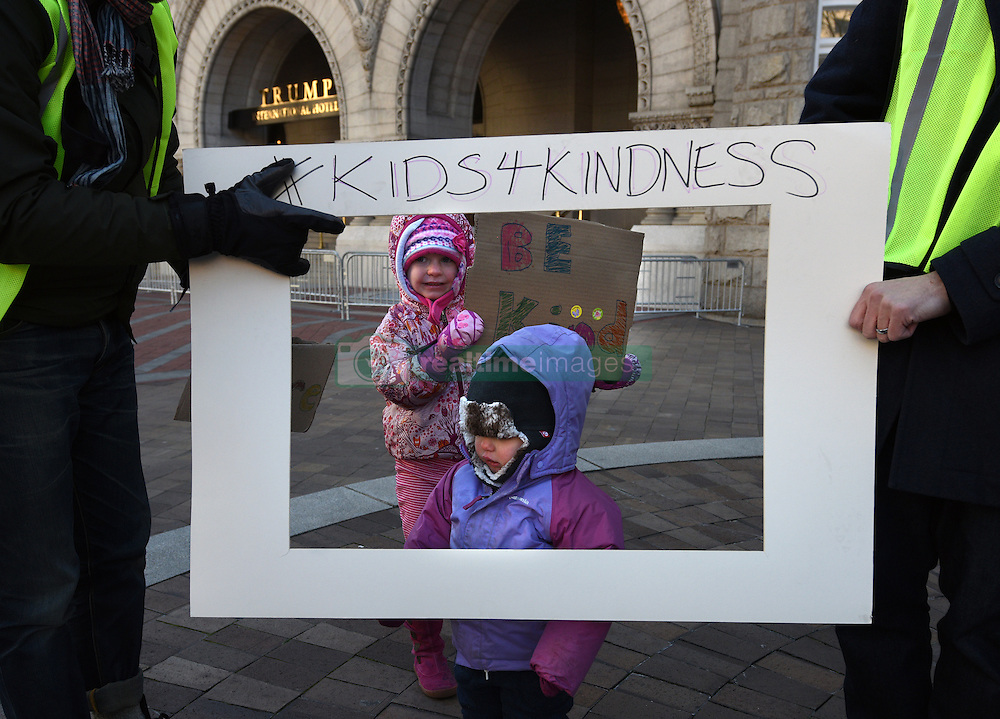"""December 10, 2016 - Washington, DC, USA - MAYA, 5 and ZOE, 1 have their picture taken inside frame of ''Photo Booth'' (Father asked not to use last name).  Children's Rally for Kindness takes place at Trump International Hotel in Washington DC on December 10, 2016 organized by the Takoma Parents Action Coalition.  According to their FaceBook page, it was a call to President-elect Donald Trump: ''to remember these lessons as he prepares to take office and implement policies that will affect the lives of children and families across our diverse nation.''.''All over the world, across cultures and countries, children learn the same basic lessons: .Ã'be kind,Ã"""" .Ã'tell the truth,Ã"""" .Ã'be fair,Ã"""" .Ã'respect everyone,Ã"""" .Ã'treat others the way you want to be treated,Ã"""" .Ã'donÃ•t touch others if they donÃ•t want to be touched. (Credit Image: © Carol Guzy via ZUMA Wire)"""
