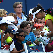 Laura Robson, Great Britain, signs autographs after her victory over Kim Clijsters, Belgium during the US Open Tennis Tournament, Flushing, New York. USA. 29th August 2012. Photo Tim Clayton
