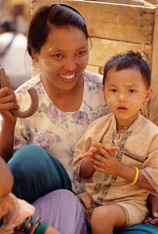 Woman and child at market, Heho Cattle auction and market, Shan State, Myanmar