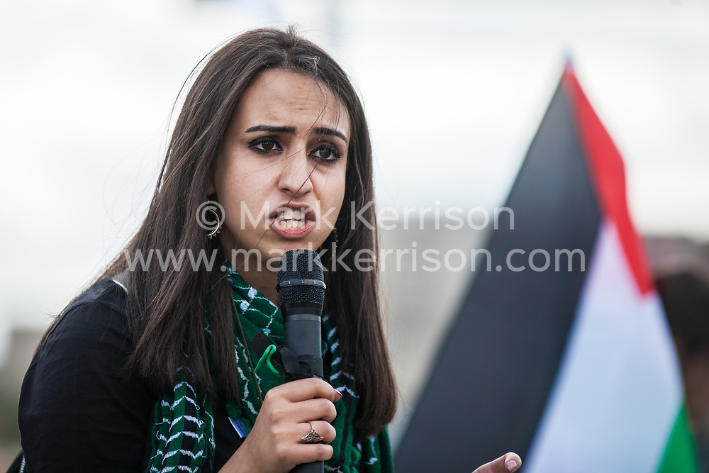 London, UK. 2 September, 2019. Huda Ammori of Palestine Solidarity Campaign addresses activists protesting outside Excel London on the first day of week-long protests against DSEI 2019, the world's largest arms fair.