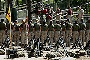 Female recruits look on as they prepare to engage in hand to hand combat themselves.  Marine Corps Recruit Depot at Parris Island in South Carolina is where all male recruits living east of the Mississippi River and all female recruits from all over the US receive their arduous twelve week training in their quest to become marines. Even though there are two current active wars and a weak economy, recruitment has not been effected.  Actually, recruiting numbers have increased, with more young men and women looking toward the military for answers.