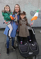 Carmel Kelly, from Rathmines with her daughters, Casey, 5, right, and Juno, 3, Daniels at the centenary Easter Rising Parade at Cuffe Street in Dublin. Picture credit; Damien Eagers 27/3/2016