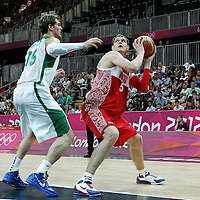 02 August 2012: Russia Timofey Mozgov eyes the basket as Tiago Splitter defends on him during 75-74 Team Russia victory over Team Brazil, during the men's basketball preliminary, at the Basketball Arena, in London, Great Britain.