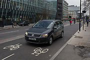 A hire car strays into the two-way cycling lanes on 9th February 2017, on Blackfriars Bridge Road, in London borough of Southwark, England. Car drivers have found it hard to adjust to new cycling priority areas and this route has been designed to improve safety and comfort for cyclists by reducing conflict with motorised traffic. It also provides new and improved pedestrian facilities. The 5km North-South route is either fully separated from traffic, or on quiet back streets. At its northern end, the route will connect with Central London Grid routes, allowing cyclists to travel safely.