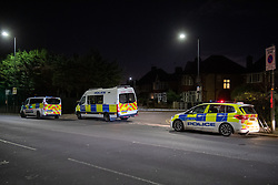 © Licensed to London News Pictures. 12/11/2020. London, UK. Police vehicles parked at the end of Northwick Avenue in Harrow. Police were called at 15:50GMT to Northwick Park, Harrow, following reports of a stabbing. Metropolitan Police Service attended and found a male, believed to be aged 17, suffering stab injuries. He was given first aid at the scene by officers prior to the arrival of London Ambulance Service. Despite the efforts of emergency services, he was pronounced dead at 16:31GMT. Photo credit: Peter Manning/LNP