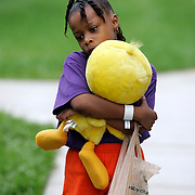 WEST PALM BEACH, FL- September 6, 2005:  Chelsea Gair, 7, walks to her room with a stuffed Tweety Bird doll on Sept. 6, 2005. She and her family evacuated from New Orleans and were flown to West Palm Beach, Floridan and sheltered at Palm Meadows, a thoroughbred training facility. (Photo by Todd Bigelow/Aurora)