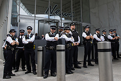 Metropolitan Police officers stand outside the offices of News UK on the ninth day of Impossible Rebellion protests by environmental activists from Extinction Rebellion on 31st August 2021 in London, United Kingdom. Extinction Rebellion are calling on the UK government to cease all new fossil fuel investment with immediate effect.