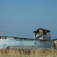 Old blue boat on beach