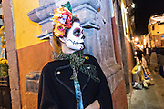 A  woman dressed as La Calavera Catrina during the Day of the Dead festival in the Jardin Principal October 28, 2016 in San Miguel de Allende, Guanajuato, Mexico. The week-long celebration is a time when Mexicans welcome the dead back to earth for a visit and celebrate life.