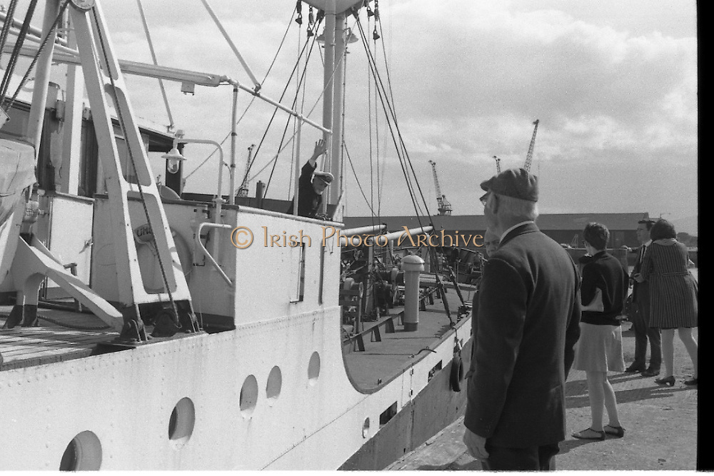 With her cargo of 600 tonnes of foodstuff, drugs and blankets for famine ridden Biafra, the Irish mercy ship Columcille sails out of Dublin, with Captain P. O'Saeghdha in command and a crew of 12, among which is a seaman priest, Rev. Fr. Joseph Fitzgibbon, the Limerick born Holy Ghost Father, who has volunteered as third engineer on the vessel.<br /> The ship sails out of Dublin Port as Captain O'Sheaghdha waves to  his family and the crowds on the quayside.<br /> 06.09.1968