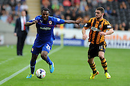 Cardiff city's Kevin Theophile-Catherine (l) holds off Hull city's Robbie Brady ®. Barclays Premier league match, Hull city v Cardiff city at the KC Stadium in Hull on Sat 14th Sept 2013. pic by Andrew Orchard, Andrew Orchard sports photography,