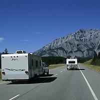 ALBERTA, CANADA. Banff National Park. Recreational vehicles on Trans-Canada Highway. Cascade Mountain bkg. (2998m)