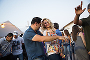 Revelers sing and dance during the Middle Eastern & Greek Food Fest at St. James Orthodox Church in Milpitas, California, on September 14, 2014. (Stan Olszewski/SOSKIphoto)
